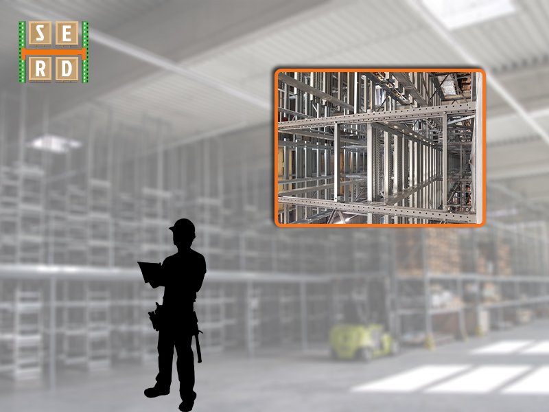 orange-and-green-metal=beam-with-blue-and-orange-pallet-rack-in-background
